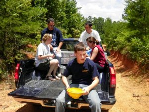 Andrew, Rachel, Brandon, Scott (me), and Melanie ride on the back of Gran-Gran's truck while moving to the next patch of berries (07.12.2010)