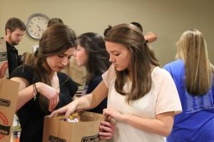 Central Teens and University Students preparing Food Bags for Distribution.